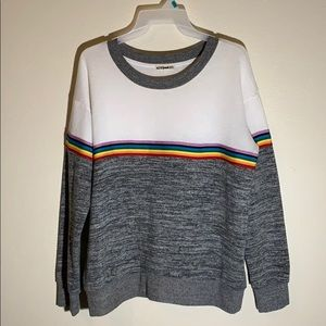 A grey and white long sleeve sweater